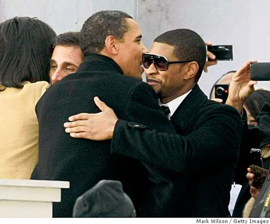 "U.S. President-elect Barack Obama (L) gets a hug from Usher during the 'We Are One: The Obama Inaugural Celebration at The Lincoln Memorial"" January 18, 2009 in Washington, DC. The event includes a diverse array of talent featuring both musical performances and historical readings and an appearance by U.S. President-elect Barack Obama. Photo: Mark Wilson, Getty Images"