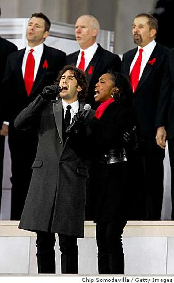 Musicians Josh Groban and Heather Headley perform in front of the Lincoln Memorial during the 'We Are One: The Obama Inaugural Celebration At The Lincoln Memorial' on January 18, 2009 at the National Mall in Washington, DC. The event includes a diverse array of talent featuring both musical performances and historical readings and an appearance by U.S. President-elect Barack Obama. Photo: Chip Somodevilla, Getty Images