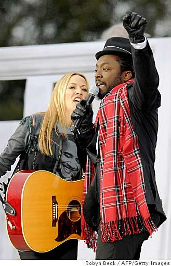 "Sheryl Crow (L) and will.i.am perform at the 'We Are One"" concert, one of the events of US president-elect Barack Obama's inauguration celebrations, at the Lincoln Memorial in Washington on January 18, 2009. Photo: Robyn Beck, AFP/Getty Images"