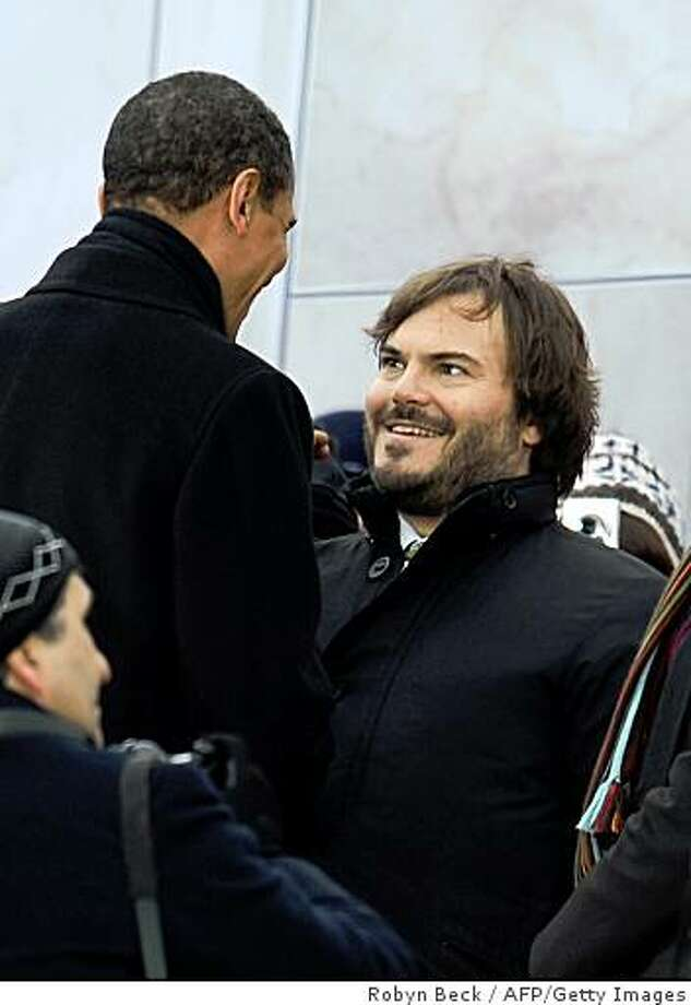 "US president-elect Barack Obama (L) talks with actor Jack Black (R) at the end of the 'We Are One"" concert, one of the events of Obama's inauguration celebrations, at the Lincoln Memorial in Washington on January 18, 2009. Photo: Robyn Beck, AFP/Getty Images"