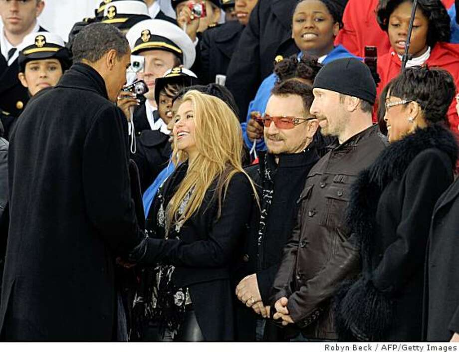 "US president-elect Barack Obama (L) talks with singer Shakira (2L), standing beside Bono (C), at the end of the 'We Are One"" concert, one of the events of Obama's inauguration celebrations, at the Lincoln Memorial in Washington on January 18, 2009. Photo: Robyn Beck, AFP/Getty Images"