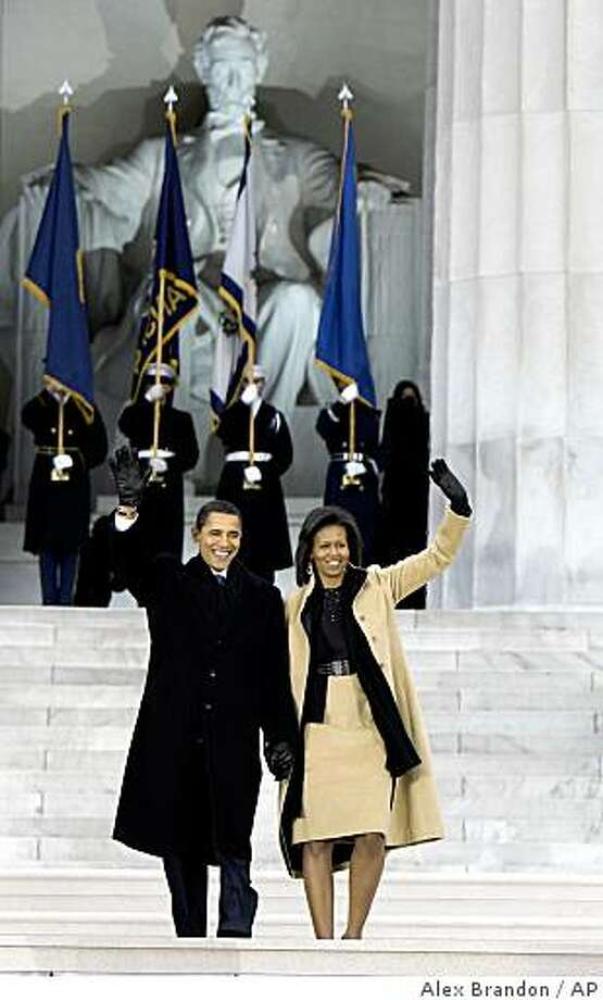 "President-elect Barack Obama, and his wife Michelle Obama, arrive at ""We Are One: Opening Inaugural Celebration at the Lincoln Memorial"" in Washington, Sunday, Jan. 18, 2009. Photo: Alex Brandon, AP"
