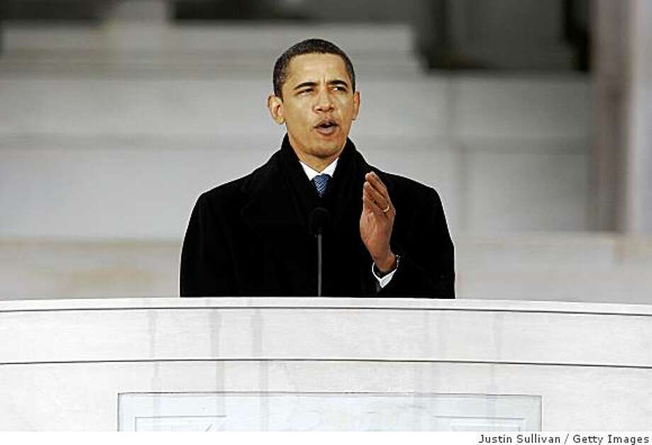 "U.S. President-elect Barack Obama speaks in front of the Lincoln Memorial  during the ""We Are One: The Obama Inaugural Celebration At The Lincoln Memorial"" on January 18, 2009 at the National Mall in Washington, DC. The event includes a diverse array of talent featuring both musical performances and historical readings and an appearance by U.S. President-elect Barack Obama. Photo: Justin Sullivan, Getty Images"