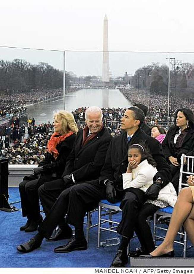 US President-elect Barack Obama (3rd L), and his daughters Sasha (R) attend he ?We are One? Inaugural Celebration at the Lincoln Memorial with Vice President-elect Joe Biden (2nd L) and his wife Jill (L) January 18, 2009 in Washington, DC. Photo: MANDEL NGAN, AFP/Getty Images