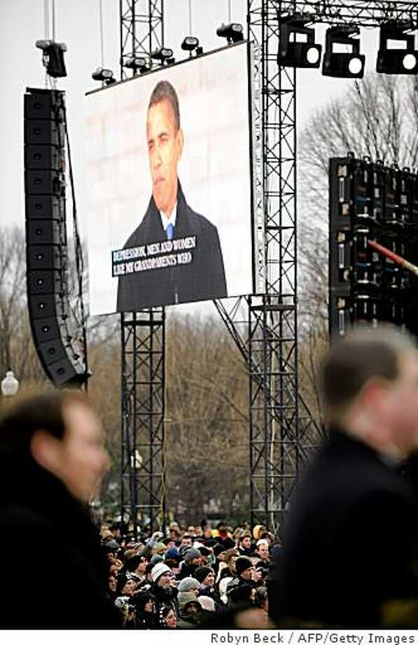 "US President-elect Barack Obama is seen on a live video relay as he speaks at the 'We Are One"" concert, one of the events of Obama's inauguration celebrations, at the Lincoln Memorial in Washington on January 18, 2009. Photo: Robyn Beck, AFP/Getty Images"