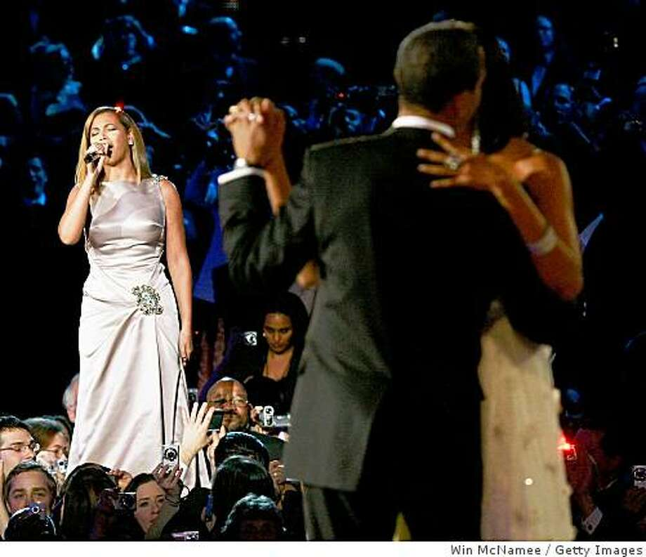 "US President Barack Obama dances with his wife and First Lady Michelle Obama as Beyonce sings ""At Last"" during the first Inaugural Ball on January 20, 2009 in Washington, DC. Photo: Win McNamee, Getty Images"