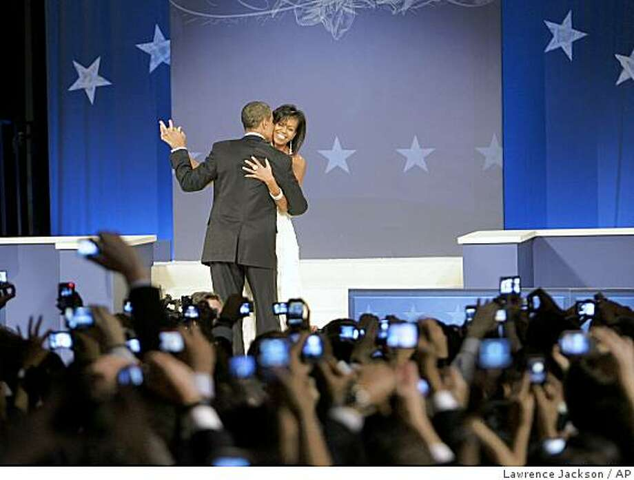 President Barack Obama and first lady Michelle Obama dance at the Western Inaugural Ball in Washington, Tuesday, Jan. 20, 2009. Photo: Lawrence Jackson, AP