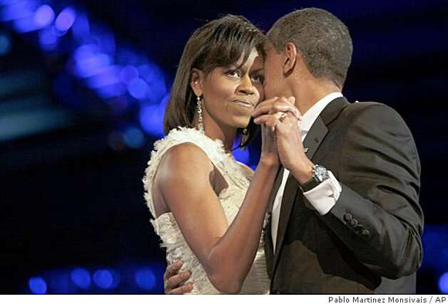 President Barack Obama and first lady Michelle Obama have their first dance of the evening during the Neighborhood Inaugural Ball in Washington, Tuesday, Jan. 20, 2009. Photo: Pablo Martinez Monsivais, AP