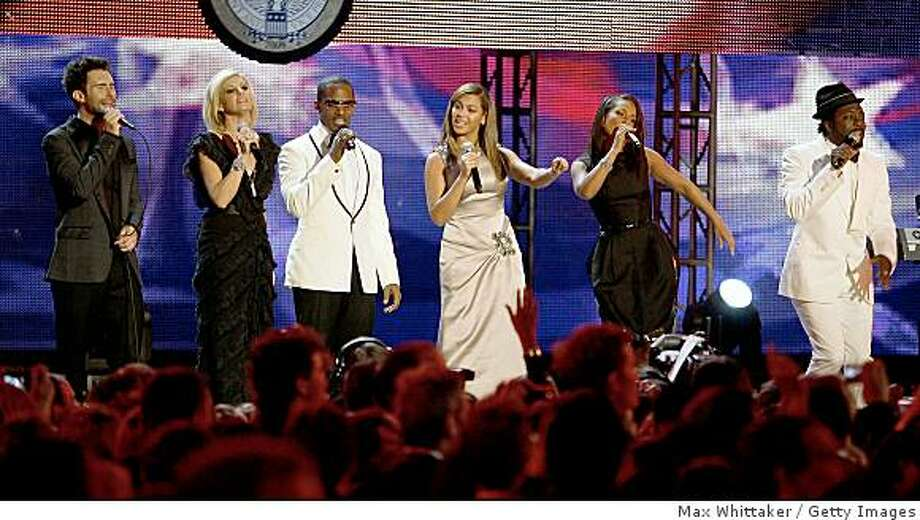 (L-R) Adam Levine of Maroon 5, Faith Hill, Jaimie Foxx, Beyonce, Alicia Keys and Will.I.Am perform for US President Barack Obama and first lady Michelle Obama during the Neighborhood Inaugural Ball on January 20, 2009 in Washington, DC. President Obama is attending ten Inaugural Balls this evening. Obama was sworn in as the 44th President of the United States today, becoming the first African-American to be elected President. Photo: Max Whittaker, Getty Images