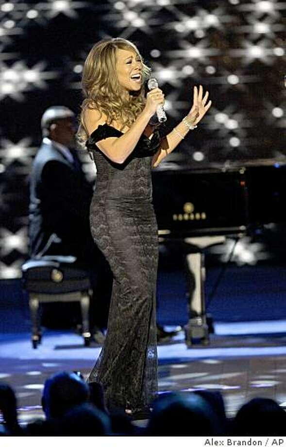 Singer Mariah Carey sings at the Neighborhood Inaugural Ball in Washington, Tuesday, Jan. 20, 2009. Photo: Alex Brandon, AP