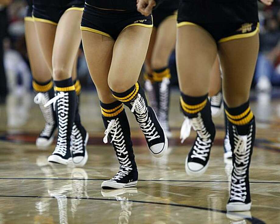 High Tops - 9:10 p.m. - Oakland.  While covering the Warriors playing against Oklahoma City Thunder, I was taken back in time by the Warrior girls who were wearing custom made high top converse shoes. Camera Settings: Canon ESO-1D Mark III, 1/800, f2.8, ISO 2000 Photo: Lance Iversen, The Chronicle