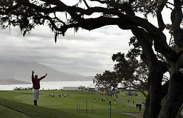 A marshal calls for the gallery to stand still as golfers on the 14th green address their puts at the Pebble Beach Golf Links during the second round of the AT&T Pebble Beach National Pro-Am golf tournament in Pebble Beach, Calif., Friday, Feb. 12, 2010. Photo: Lance Iversen, The Chronicle