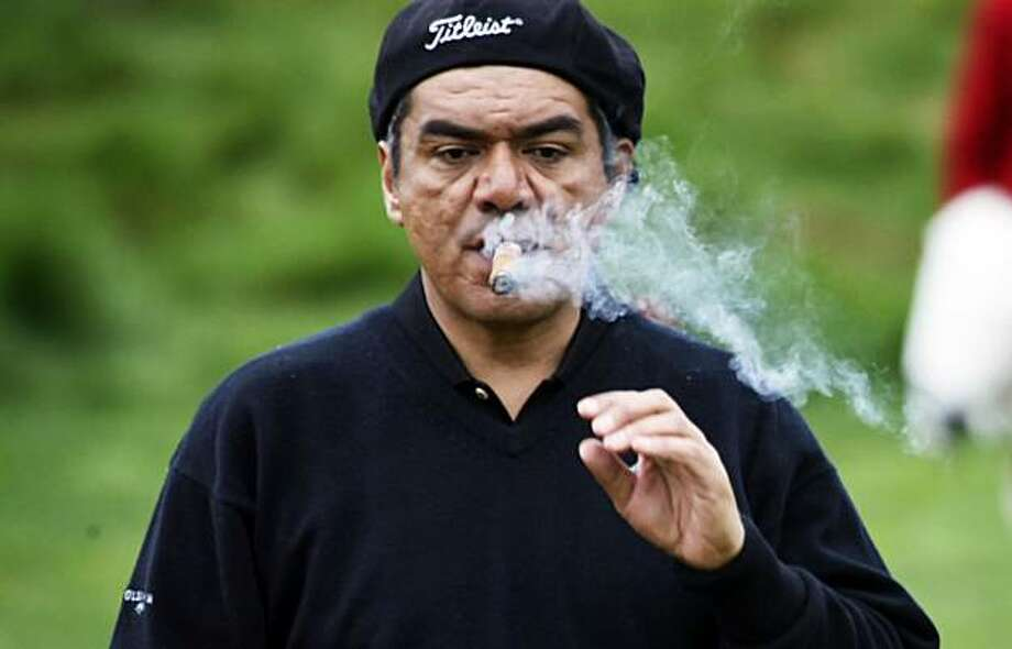 Comedian George Lopez lights up at Pebble Beach while taking part in the annual 3M Celebrity Challenge Wednesday Feb. 10, 2010. The charity event is part of the 25th annual AT&T Pro-Am golf tournament that begins Thursday with a field of 156 pro and amateur golfers taking part. Photo: Lance Iversen, The Chronicle