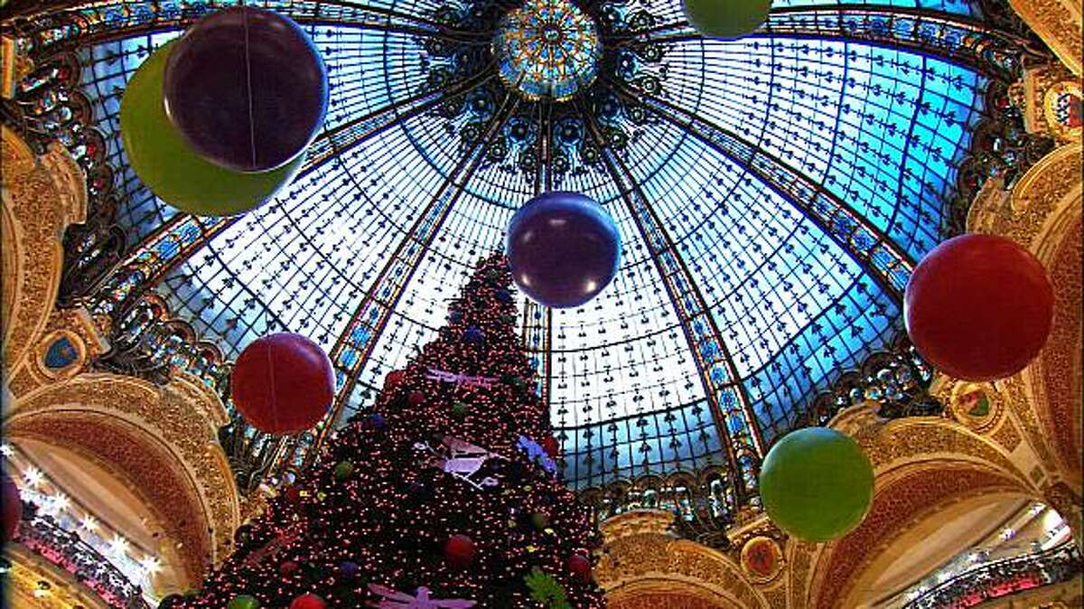 The spectacular stained-glass dome at the Galeries Lafayette department store is particularly festive during the holiday season.