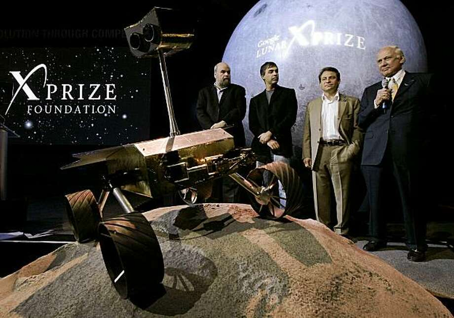 Dr. Buzz Aldrin, right, an Apollo Astronaut, responds to a question while Bob Weiss, left, Vice-Chairman, X Prize Foundation, Larry Page, second from left, Co-Founder & President, Products, Google and Dr. Peter Diamondis, Chairman and CEO, X Prize Foundation listen, Thursday, Sept. 13, 2007, in Los Angeles. Google Inc. is bankrolling a $30 million out-of-this-world prize to the first private company that can safely land a robotic rover on the moon and beam back a gigabyte of images and video to Earth. (AP Photo/Ric Francis) Photo: Ric Francis, AP