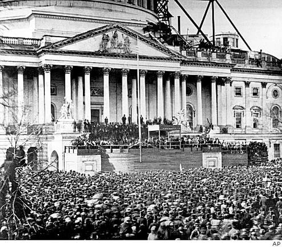 ** FILE ** In this March 4, 1861, file photo, President Abraham Lincoln stands under cover at center of Capitol steps during his inauguration in Washington, D.C., on March 4, 1861.  The scaffolding at upper right is used in construction of the Capitol dome. Some of the inaugurations that loom large in history were seen quite differently at the time.  (AP Photo) Photo: AP