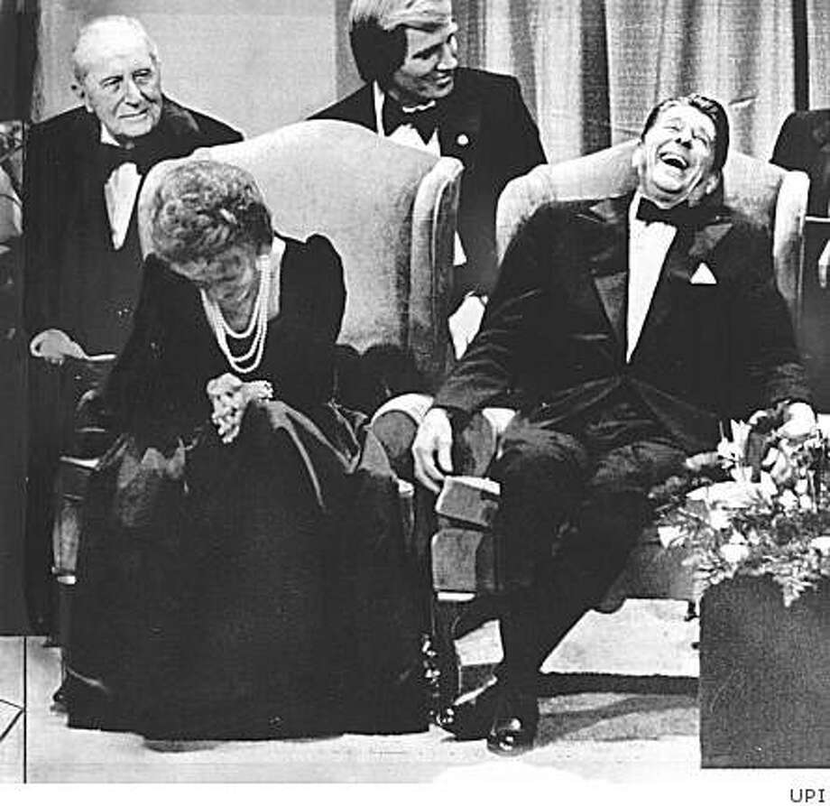 Inauguration_ph19.JPG January 19, 1981  - President elect Ronald Reagan breaks up as his wife, Nancy, doubles over in laughter during comedian Rich Little's performance at the inaugural gala honoring the Reagans. Photo: UPI