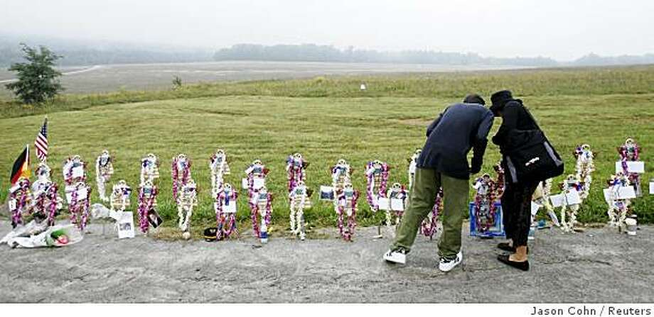 Grant Woolacott (L) and his mother Dallas, of West Hartford, Connecticut, place letters to each of the passengers and crew of Flight 93 at the Flight 93 Temporary Memorial outside Shanksville, Pennsylvania, September 11, 2007. Tuesday is the sixth anniversary of the attacks on New York, Washington, and Pennsylvania. The plane crashed in the field beyond the memorial. Photo: Jason Cohn, Reuters