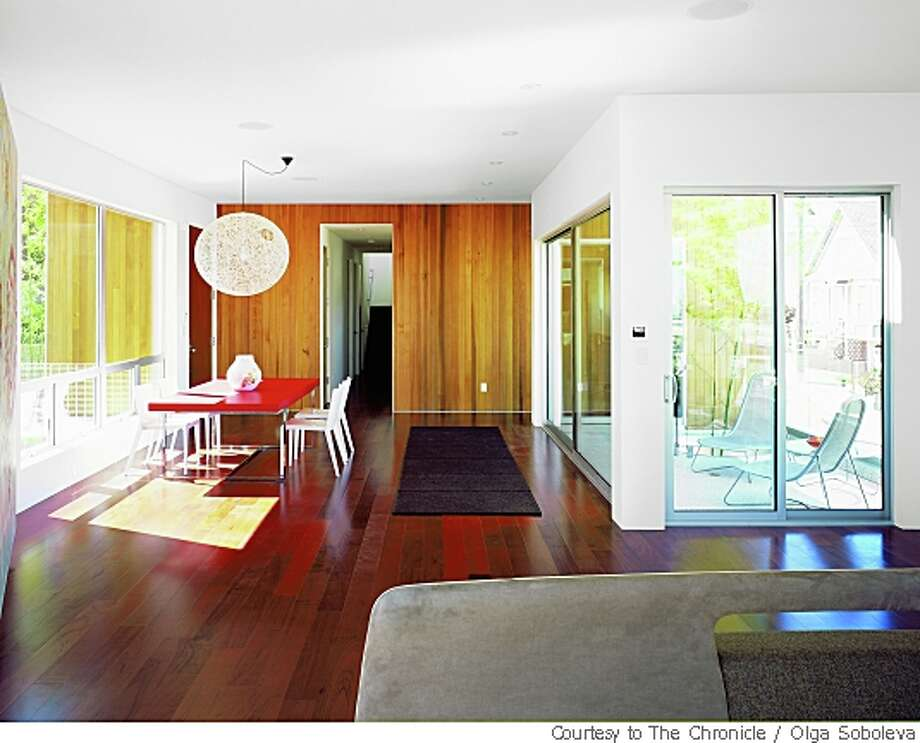 Floor-to-ceiling sliding glass doors open from the master bedroom onto a deck, left, on the uniquely designed Bernal Heights home on Mullen, above. Photo: Olga Soboleva, Courtesy To The Chronicle