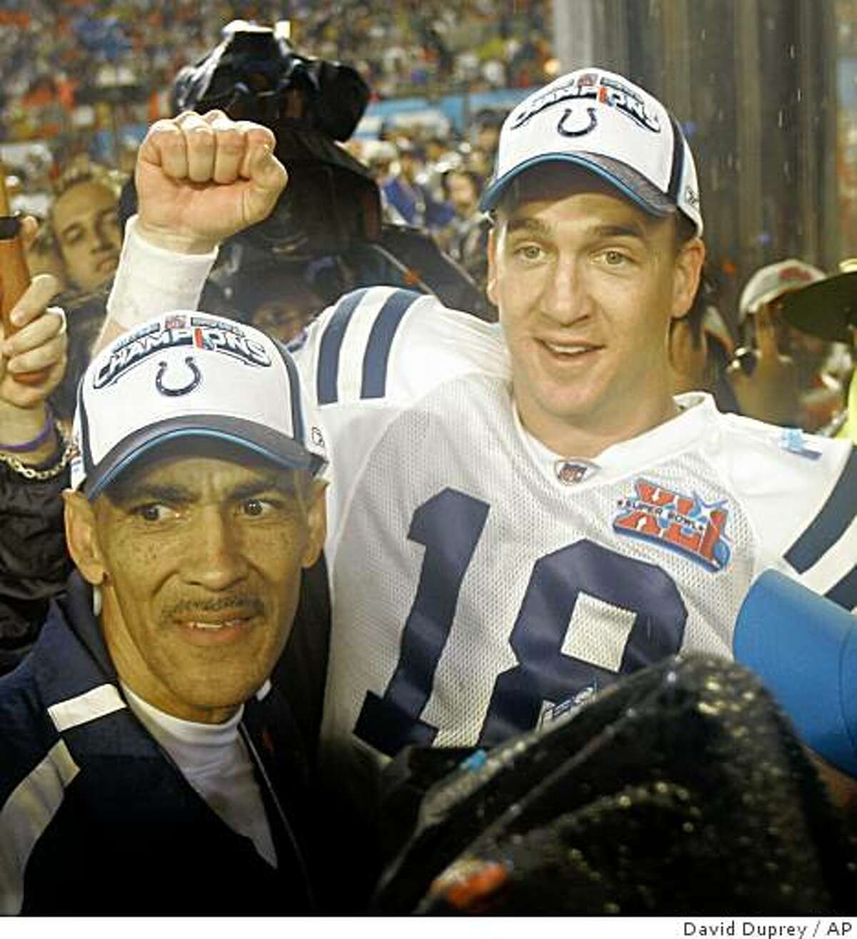 Indianapolis Colts head coach Tony Dungy and Indianapolis Colts quarterback Peyton Manning (18) are seen after defeating the Chicago Bears 29-17 to win the Super Bowl XLI football game at Dolphin Stadium in Miami, Sunday, Feb. 4, 2007. (AP Photo/David Duprey)