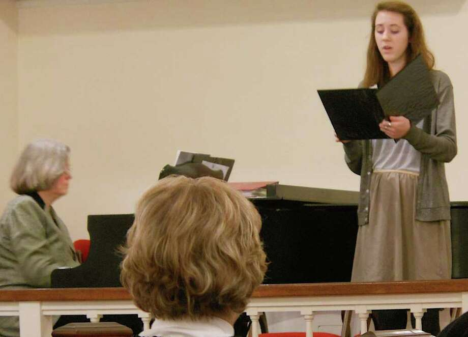 Alice Caldwell, the music director at Our Saviour's Lutheran Church, plays piano while Katie Jenks sings a hymn celebrating Epiphany with traditional Moravian music in a Jan. 8 service at the Fairfield church. Photo: Mike Lauterborn / Fairfield Citizen contributed