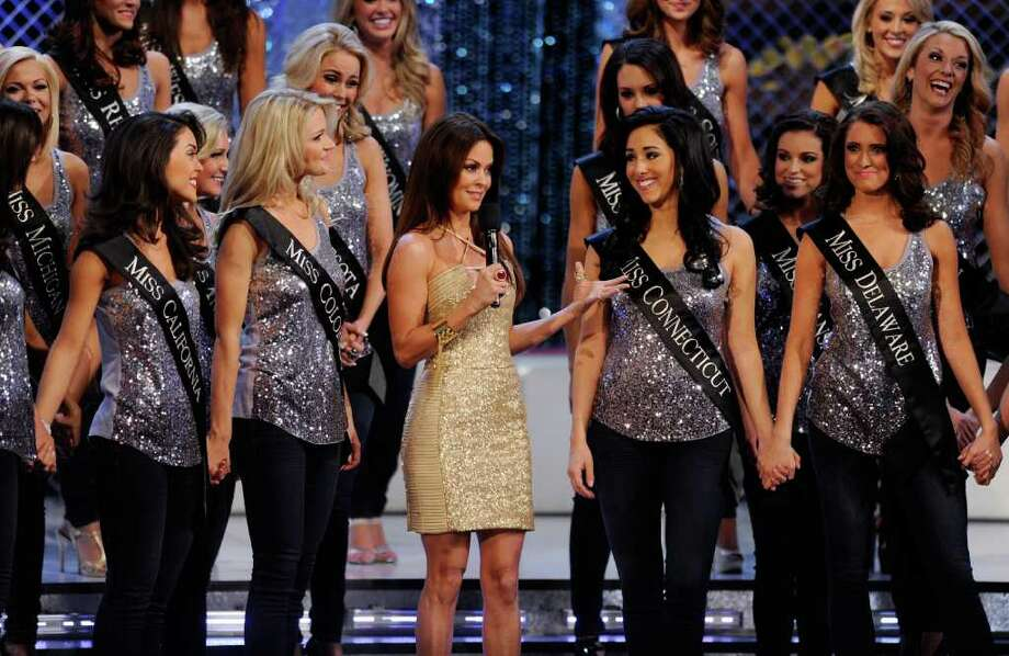 LAS VEGAS, NV - JANUARY 14:  Television personality Brooke Burke Charvet (C) stands with contestants as she hosts the 2012 Miss America Pageant at the Planet Hollywood Resort & Casino January 14, 2012 in Las Vegas, Nevada. Photo: Ethan Miller, Getty Images / 2012 Getty Images
