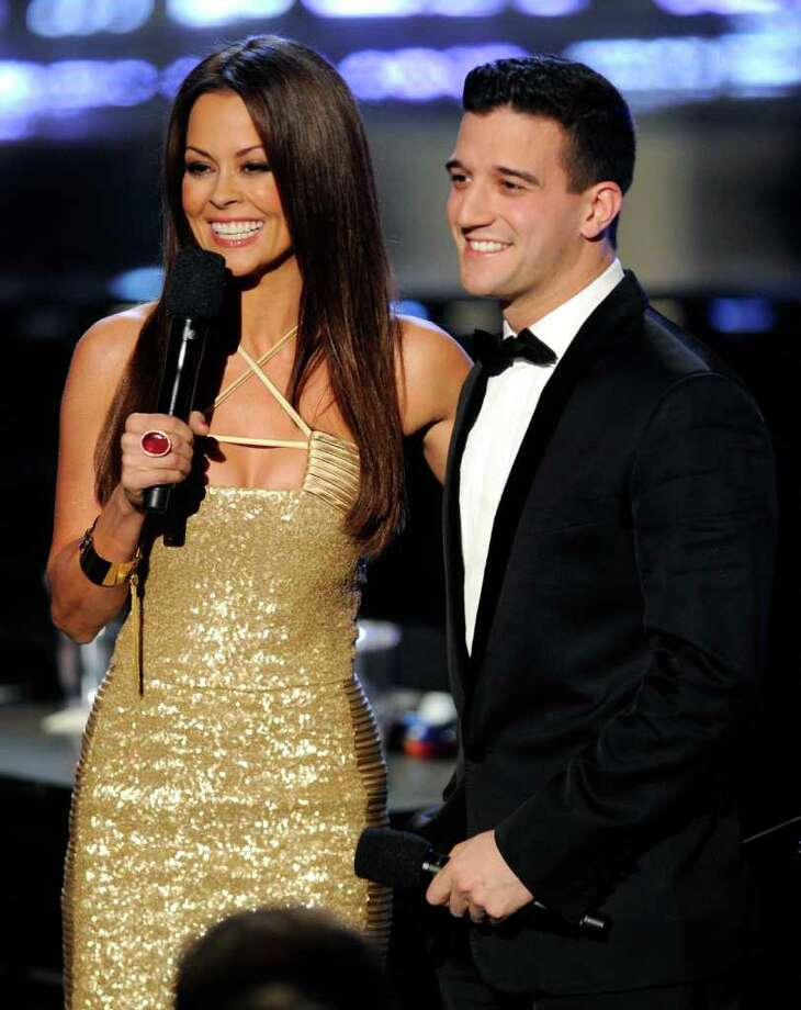 LAS VEGAS, NV - JANUARY 14:  Television personality and pageant co-host Brooke Burke Charvet (L) talks with pageant judge and dancer Mark Ballas during the 2012 Miss America Pageant at the Planet Hollywood Resort & Casino January 14, 2012 in Las Vegas, Nevada. Photo: Ethan Miller, Getty Images / 2012 Getty Images