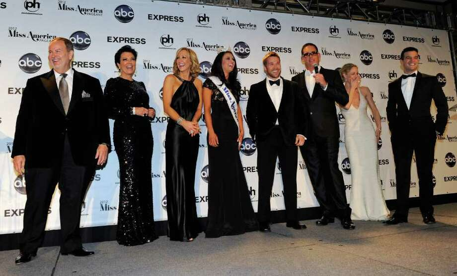 LAS VEGAS, NV - JANUARY 14:  Judges appear with Laura Kaeppeler (4th L), Miss Wisconsin, during a news conference after she was named the new Miss America during the 2012 Miss America Pageant at the Planet Hollywood Resort & Casino January 14, 2012 in Las Vegas, Nevada. Judges (L-R) are television personality and writer Raul de Molina, television personality Kris Jenner, journalist Lara Spencer, fitness trainer Chris Powell, producer Mike Fleiss, actress Teri Polo and dancer Mark Ballas. Photo: Ethan Miller, Getty Images / 2012 Getty Images