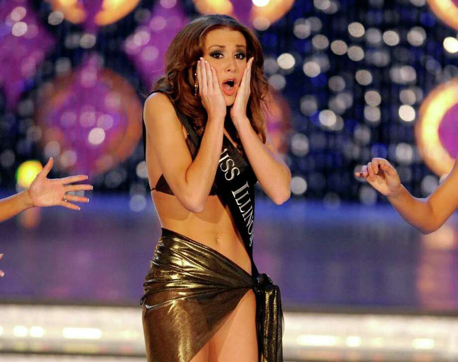 LAS VEGAS, NV - JANUARY 14:  Hannah Smith, Miss Illinois, reacts after being named a top 13 finalist following the swimsuit competition during the 2012 Miss America Pageant at the Planet Hollywood Resort & Casino January 14, 2012 in Las Vegas, Nevada. Photo: Ethan Miller, Getty Images / 2012 Getty Images