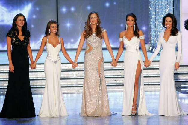 Miss Wisconsin Laura Kaeppeler, left, Miss Oklahoma Betty Thompson, Miss Arizona Jennifer Sedler, Miss New York Kaitlin Monte and Miss California Noelle Freeman compete as the top five finalists during the 2012 Miss America Pageant Saturday Jan. 14, 2012 at The Planet Hollywood Resort & Casino in Las Vegas. Kaeppeler went on to win the contest. (AP Photo/Eric Jamison) Photo: Eric Jamison, Associated Press / FR156391 AP