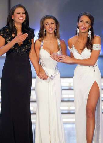 Miss Wisconsin Laura Kaeppeler, left, Miss Oklahoma Betty Thompson and Miss New York Kaitlin Monte react as Monte is named second runner up during the 2012 Miss America Pageant Saturday Jan. 14, 2012 at The Planet Hollywood Resort & Casino in Las Vegas. Kaeppeler went on to win the contest. (AP Photo/Eric Jamison) Photo: Eric Jamison, Associated Press / FR156391 AP