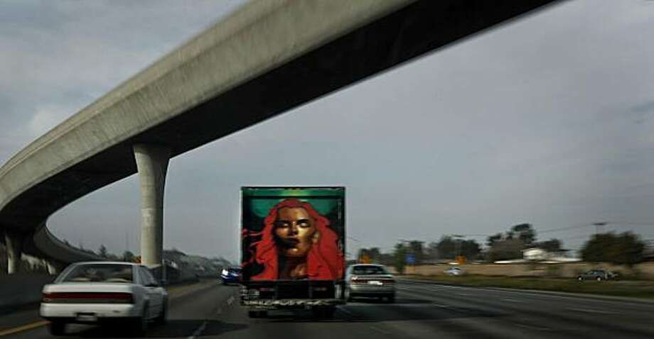 Mobile Art- 2:23pm - San Mateo Highway 101  Followed a truck painted with graffiti art on the read door, traveling up highway 101 North Bound in San Mateo.  Camera Settings: ISO 50, f 22, 1/15, Canon 5D Mark II Photo: Michael Macor, The Chronicle