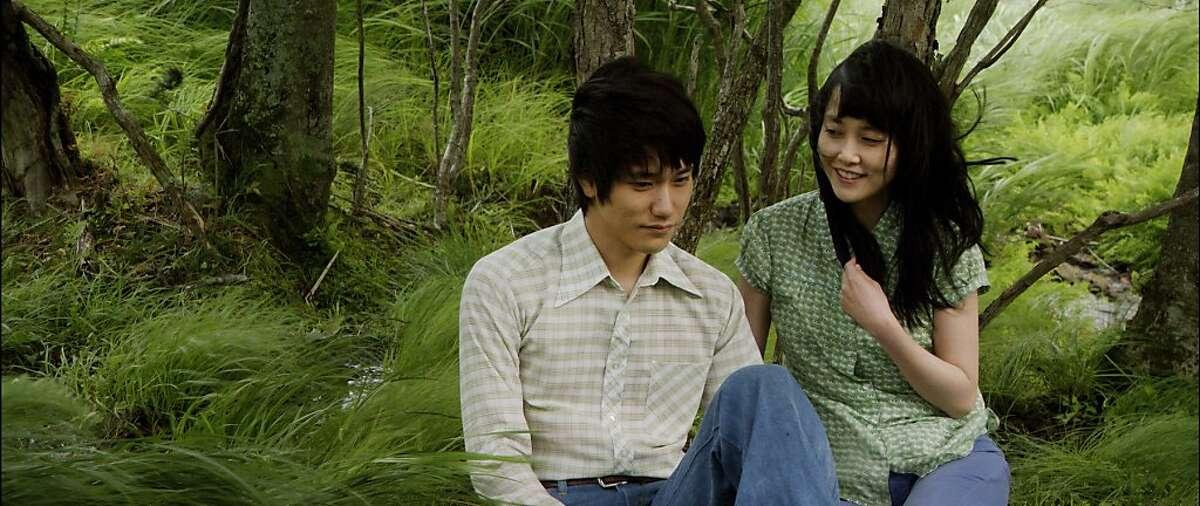 Kenichi Matsuyama, left, and Rinko Kikuchi in a scene from the 2012 film