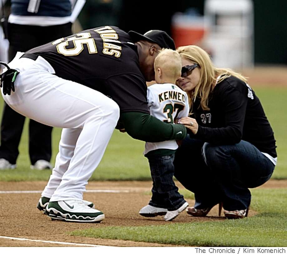 Oakland's Frank Thomas returns the ball to Kaige Kennedy, age 2, as his mother Jami watches after first pitch ceremonies at McAffee Coliseum on Saturday, May 25, 2008. Jami and Kaige are widow and son of A's player Joe Kennedy, who died in November, 2007. Joe Kennedy would have been 29 today.Photo by Kim Komenich / San Francisco Chronicle Photo: Kim Komenich, SFC