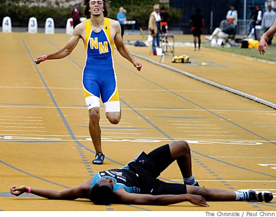 Josh Winfield, of Deer Valley High School, sprawls on the track in front of Newark Memorial's Andrew Akre after Winfield's first place finish in the boys 400 meter run at the North Coast Section track and field championships at Edwards Stadium in Berkeley, Calif., on Saturday, May 24, 2008.Photo by Paul Chinn / San Francisco Chronicle Photo: Paul Chinn, Chronicle