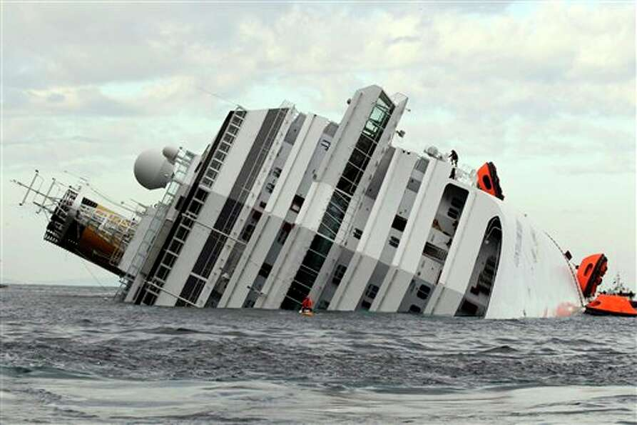 The luxury cruise ship Costa Concordia lies on its side  after it ran aground off the tiny Tuscan is
