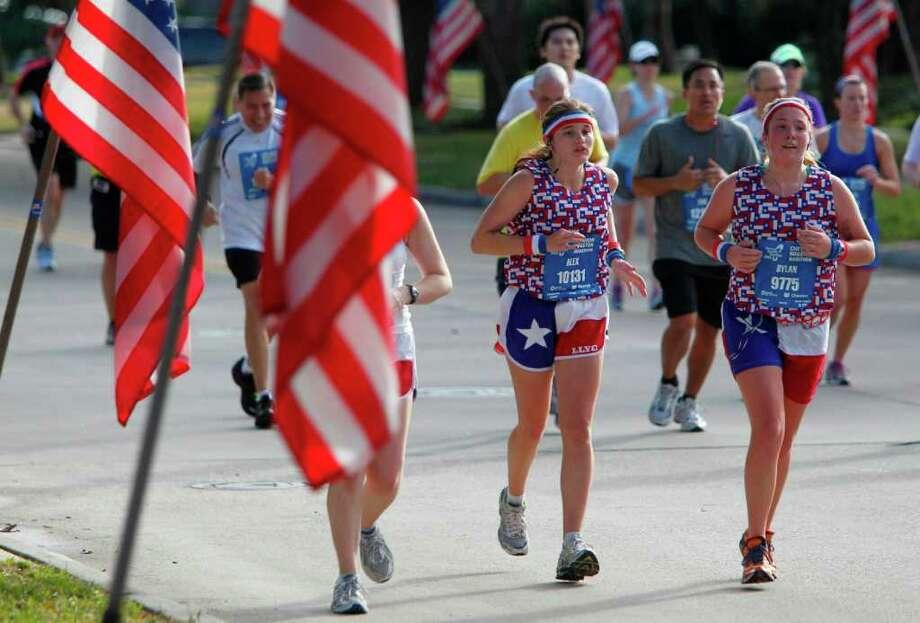 The Chevron Houston Marathon and the Aramco Houston Half Marathon draws nearly 25,000 runners each year. Photo: Mayra Beltran, Houston Chronicle / © 2011 Houston Chronicle