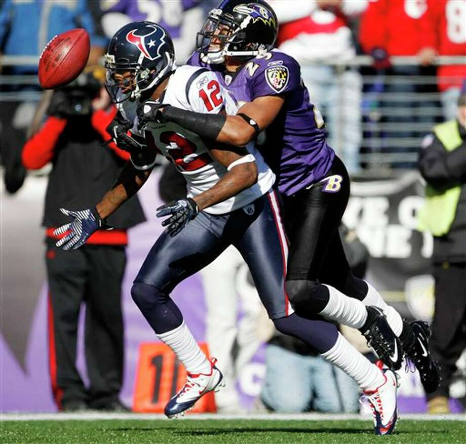 Houston Texans wide receiver Jacoby Jones fumbles the ball under pressure from Baltimore Ravens cornerback Cary Williams during the first half of an NFL divisional playoff football game in Baltimore, Sunday, Jan. 15, 2012. (AP Photo/Evan Vucci) Photo: Evan Vucci, Associated Press / AP