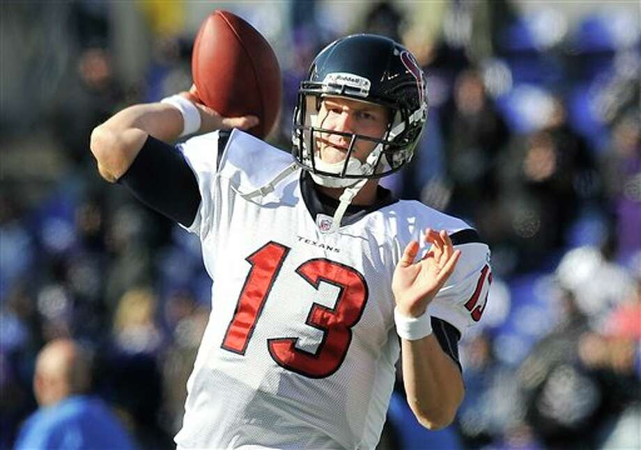 Houston Texans quarterback T.J. Yates warms up before an NFL divisional playoff football game against the Baltimore Ravens in Baltimore, Sunday, Jan. 15, 2012. (AP Photo/Gail Burton) Photo: Gail Burton, Associated Press / FR4095 AP