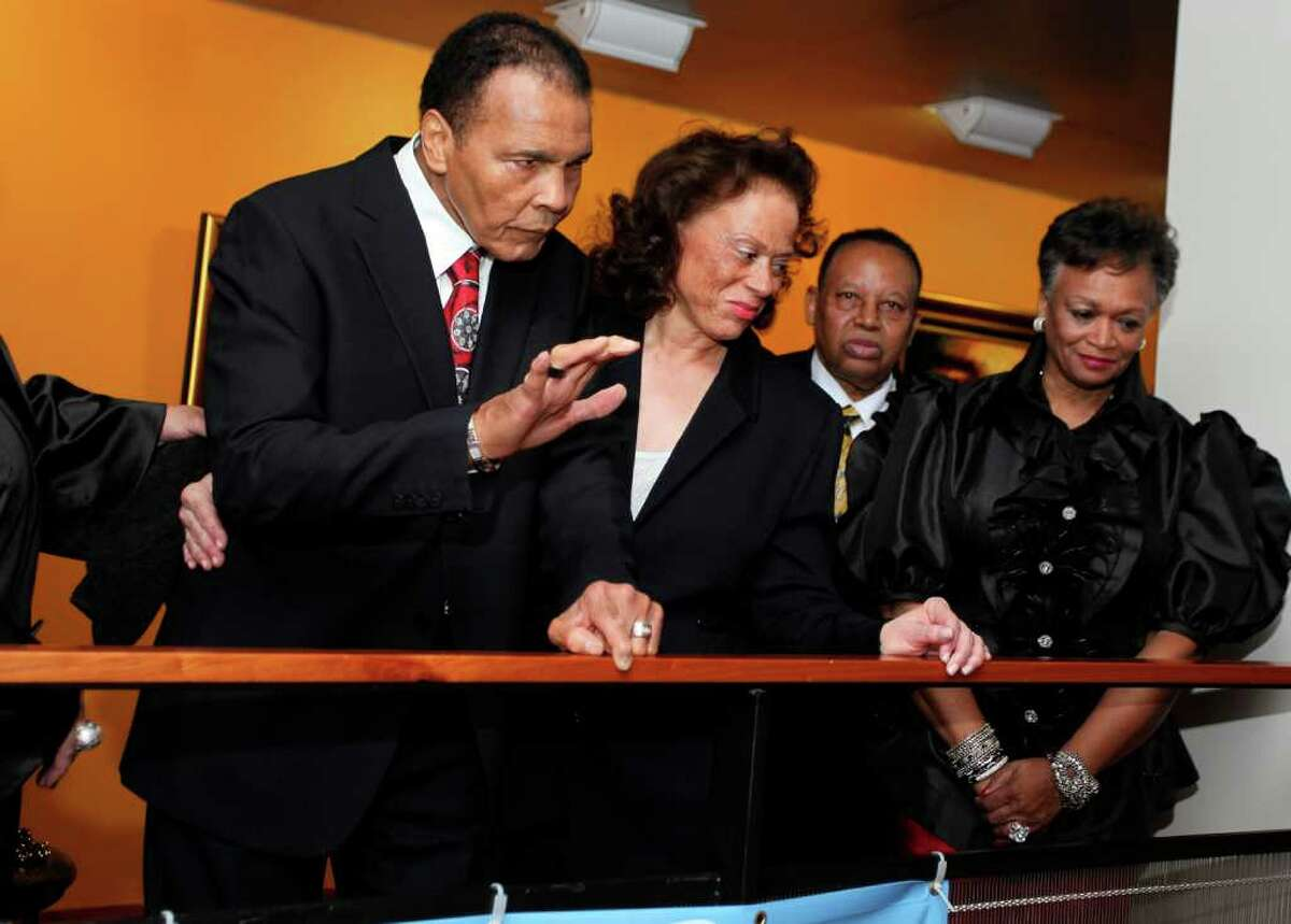 Muhammad Ali., left, welcomes his guests along with his wife Lonnie Ali, center, at a fund raiser for the Muhammad Ali Center in his hometown of Louisville, Ky., on Saturday, Jan. 14, 2012. Ali turns 70 Tuesday. (AP Photo/ The Muhammad Ali Center)