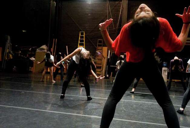Kristen Greto, right, and her sister Karla practice as choreographer Luis Salgado leads a Latin jazz class during the 10nth DanceFest Master Classes at the Palace Theatre in Stamford, Conn., January 15, 2012.  In addition to the Latin jazz there were hip hop and tap classes. Photo: Keelin Daly / Stamford Advocate