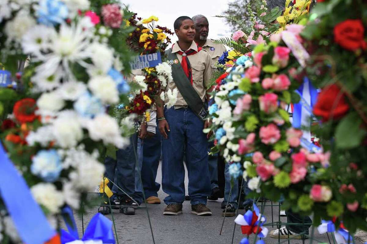 METRO -- Bethel AME Church Boy Scout Troop 96 Raheem Poindexter, 15, front, and Assistant Scout Master Edward Costley line up to lend a hand at Martin Luther King Plaza for a wreath-laying ceremony, Sunday, Jan. 15, 2012. Various organizations participated in the yearly event at the corner of North New Braunfels Avenue and East Houston Street. JERRY LARA/glara@express-news.net