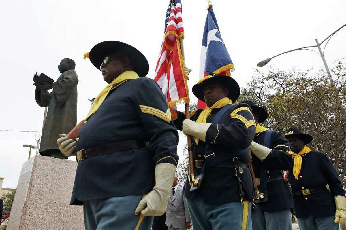 METRO -- Members of the Bexar County Buffalo Soldiers from left, Ken Vaughn, Billy Gordon, Turner McGarity and Ed Hardy present the colors at the start the Rev. Dr. Martin Luther King, Jr., Wreath-Laying Ceremony, Sunday, Jan. 15, 2012. Various organizations participated in the yearly event at the corner of North New Braunfels Avenue and East Houston Street. JERRY LARA/glara@express-news.net