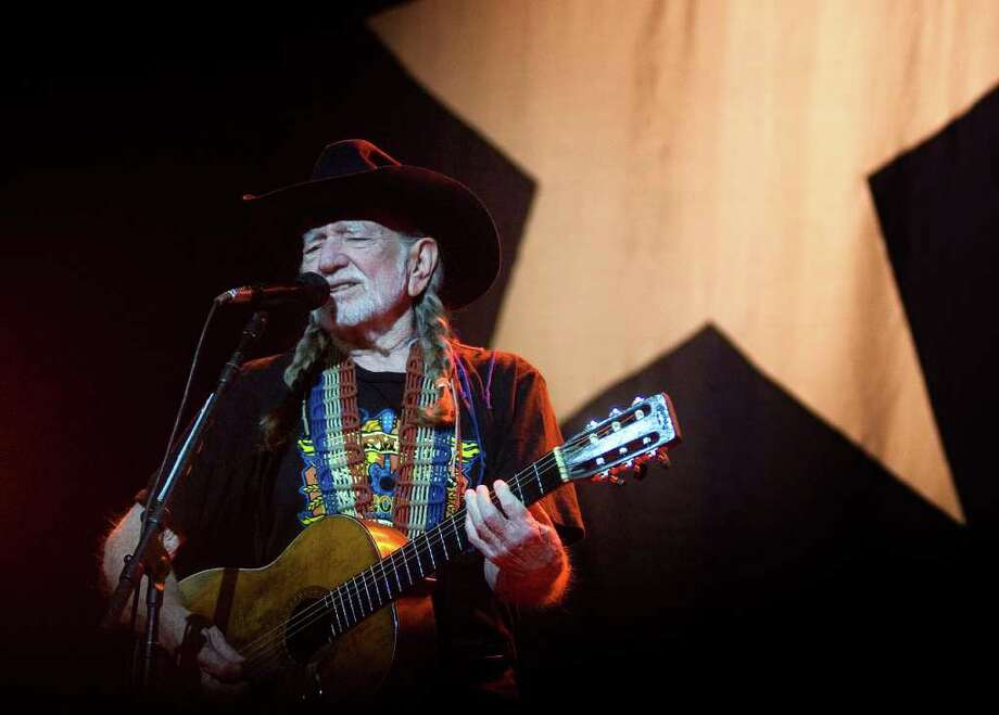 "Country music singer Willie Nelson performs ""Whiskey River"" to a full house Sunday night, Jan. 8, 2012 at the Perot Theatre in Texarkana, Texas. Photo: Christena Dowsett, AP / Texarkana Gazette"
