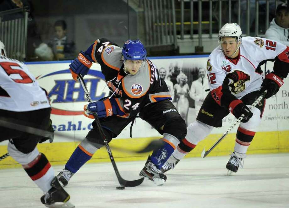 Sound Tiger David Ullstrom stick handles the puck in front of Binghampton defender Pat Cannone, right during their matchup at the Webster Bank Arena in Bridgeport on Sunday, January 15, 2012. Photo: Brian A. Pounds / Connecticut Post