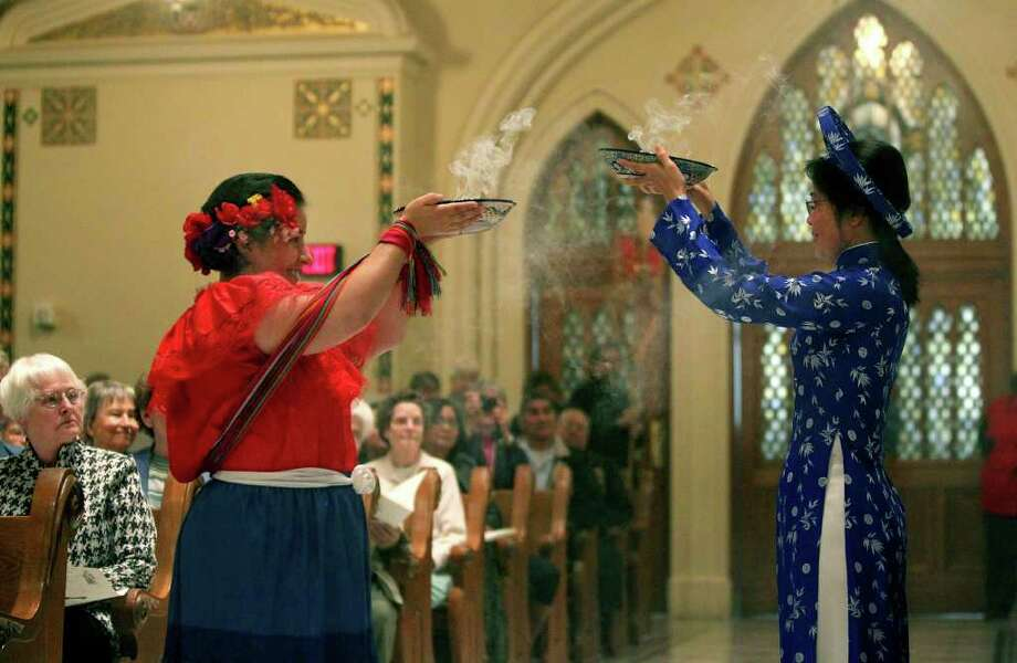 Incense bearer Sister Elizabeth Ann Guerrero (left) and incense bearer Sister My-Hanh Tran (right) lead a procession Sunday January 15, 2012 at Sacred Heart Conventual Chapel at Our Lady of the Lake University. The procession marked the beginning of a celebration of the 250th anniversary of the Sisters of Divine Providence at Our Lady of the Lake Convent and the Missionary Catechists of Divine Providence at St. Andrew's Convent. Five other groups of sisters from France and Belgium were also included in the anniversary celebration. JOHN DAVENPORT/jdavenport@express-news.net Photo: SAN ANTONIO EXPRESS-NEWS