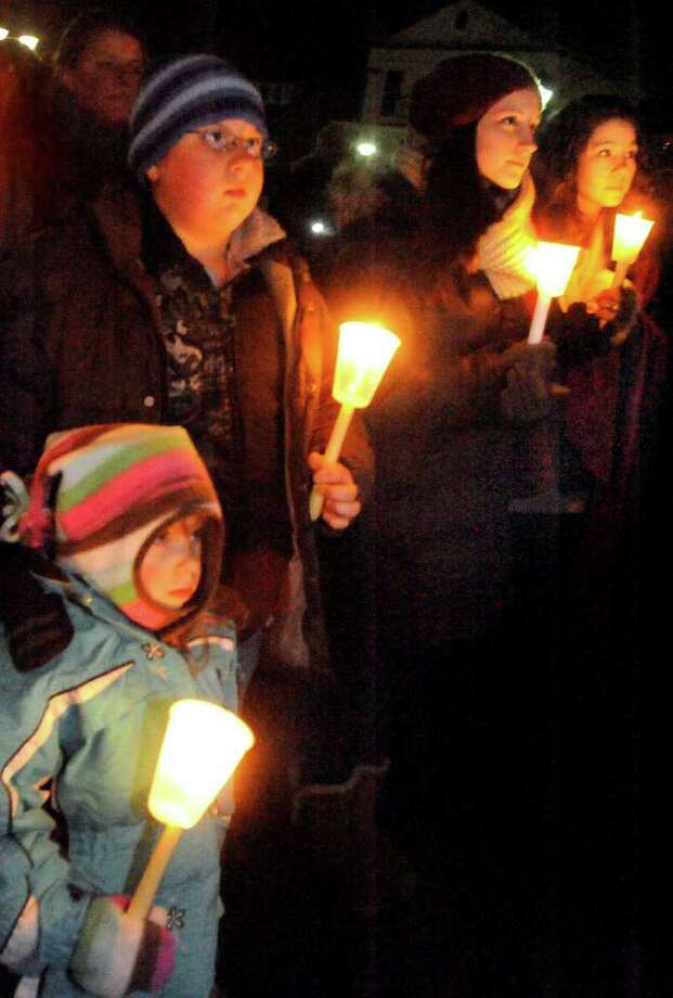 Alea Slater, 4, and her brother Brandon, 10, are among supporters of former New Milford High School teacher Steve Flanagan during a candlelight vigil for him on the Village Green Sunday, Jan. 15, 2012. Photo: Michael Duffy / The News-Times