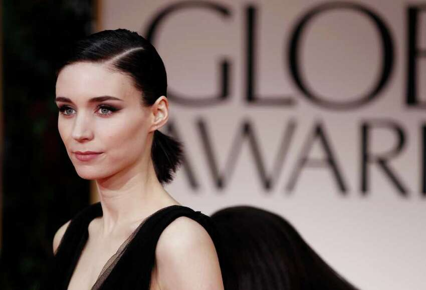 Rooney Mara arrives at the 69th Annual Golden Globe Awards Sunday, Jan. 15, 2012, in Los Angeles.