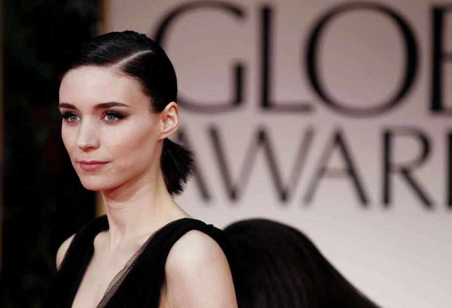The girl without a dragon tattoo:Rooney Mara, her hair pulled back in a short ponytail and sans gems, wore an edgy Nina Ricci gown that featured top and side bands. The look suited her Lisbeth Salander movie role. Photo: Matt Sayles