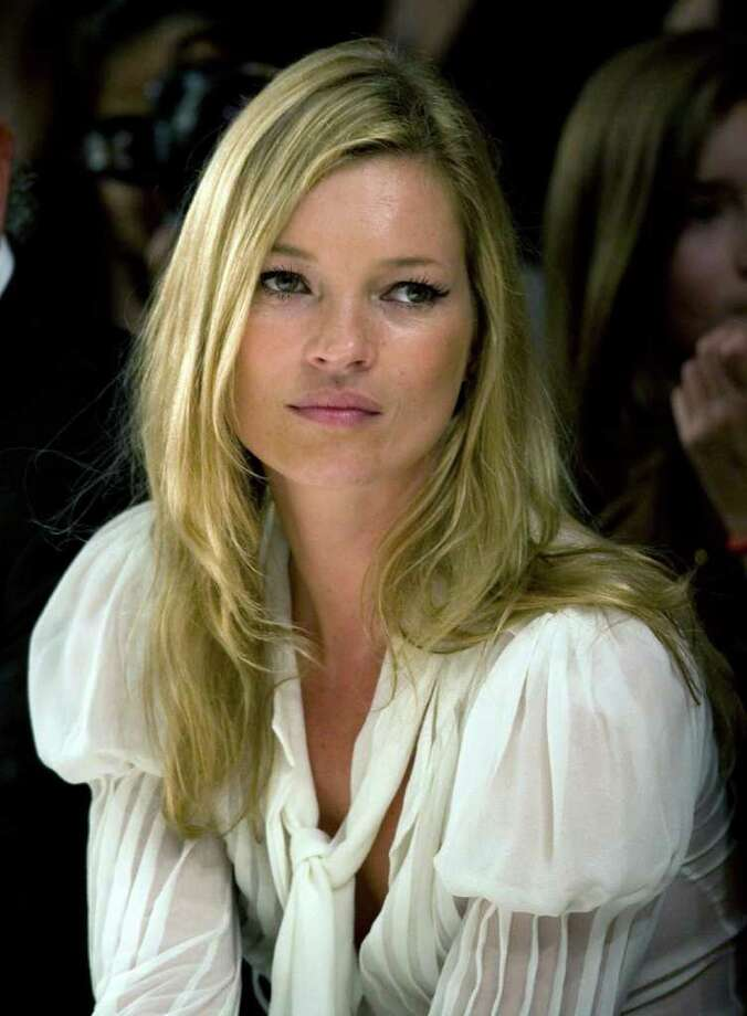 "In 2005, Super model Kate Moss was busted cutting up lines and snorting cocaine in a front page photo of the UK gossip magazine ""The Daily Mirror."" Photo: Kevin Coombs, REUTERS / X00066"